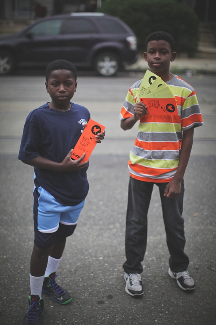 Jamal and Yahya, flyering the neighborhood. Yahya is color coordinated.