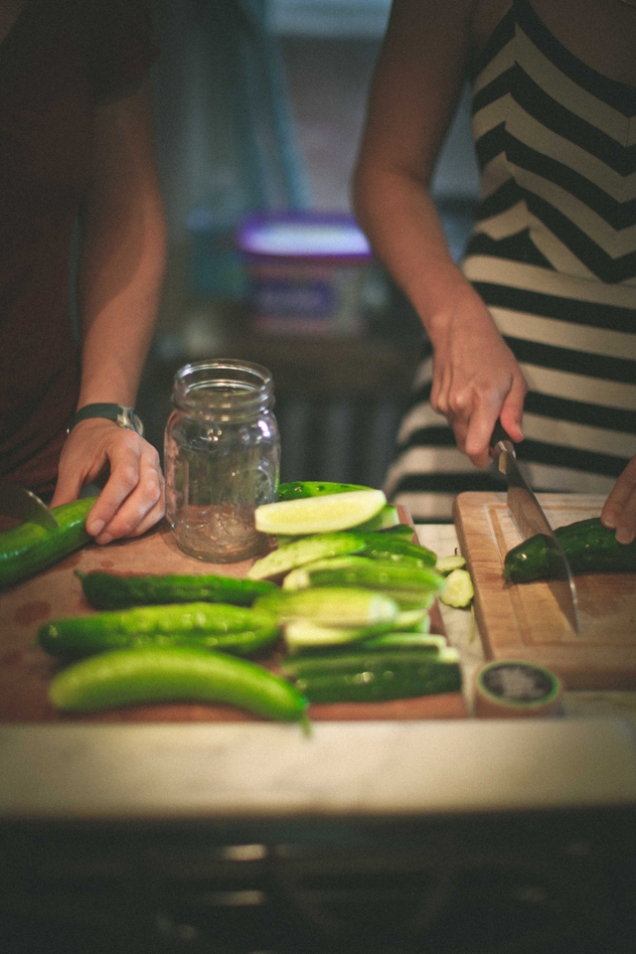 Chloe and Katie prepping the cukes